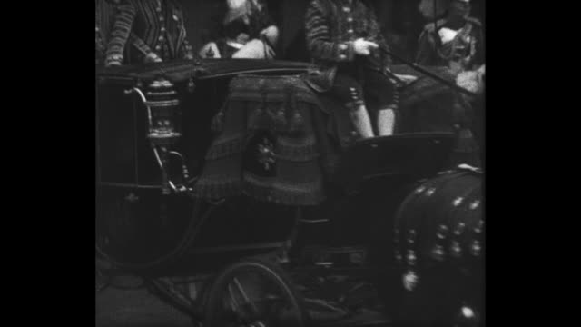 carriage bearing princess marina heads for westminster abbey for her wedding to prince george, duke of kent, as crowds line street / marina waves... - archbishop of canterbury stock videos & royalty-free footage