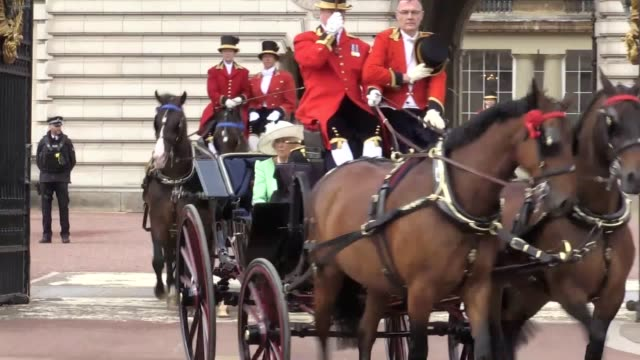 a carriage carrying the duchess of cornwall the duchess of cambridge and the duke and duchess of sussex and another carriage carrying the queen... - colours stock videos & royalty-free footage
