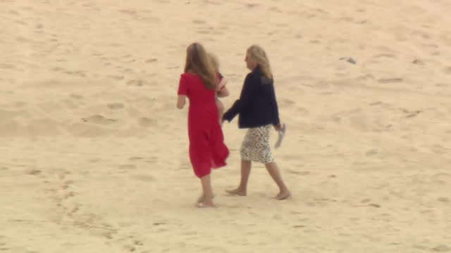 carrie symonds and first lady jill biden, wives of uk prime minister boris johnson and us president joe biden, walk along beach at carbis bay,... - son stock videos & royalty-free footage