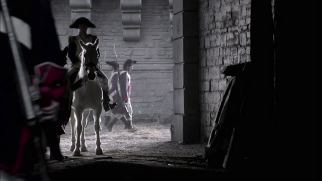 a carrier delivers a message to a mounted military leader near marching soldiers in french revolution uniforms. - french revolution stock videos & royalty-free footage
