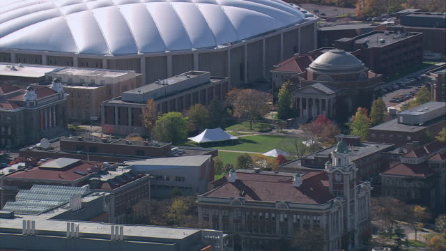 aerial carrier dome and surrounding syracuse university buildings and grounds / syracuse, new york, united states - dome stock videos & royalty-free footage