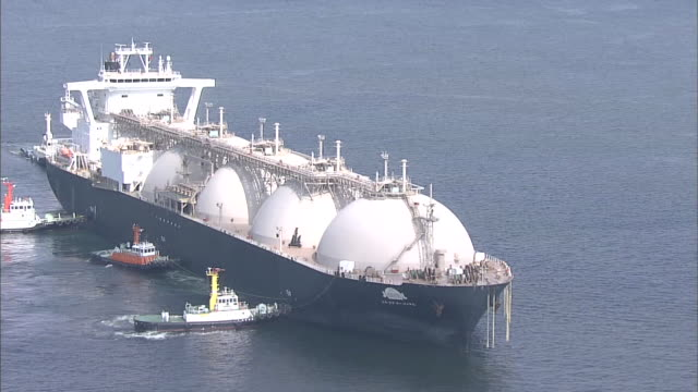 lng carrier in osaka bay - storage tank stock videos and b-roll footage