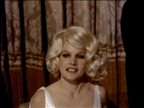 """carroll baker in publicity filming for movie """"harlow"""" at the paramount studios lot. carroll is dressed in costume as jean harlow. grand ballroom... - paramount pictures stock videos & royalty-free footage"""
