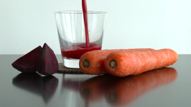 carrot and beetroot juice - beet stock videos & royalty-free footage