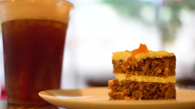 carrot cake iced fruit tea at cafe - carrot stock videos & royalty-free footage