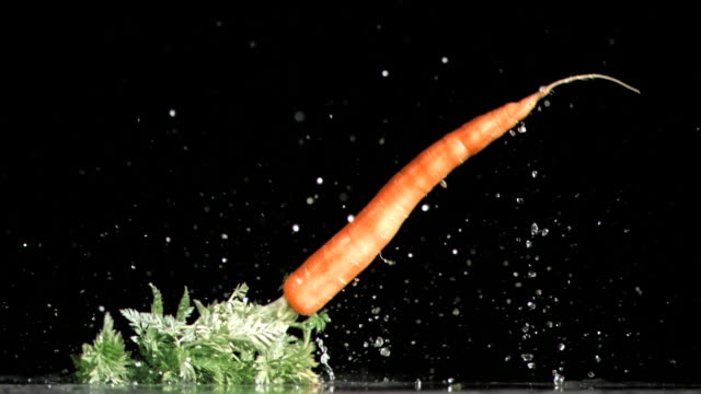carrot falling in super slow motion - möhre stock-videos und b-roll-filmmaterial