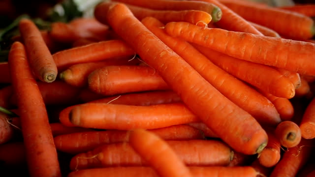 carrots at the market,close up - market stall stock videos & royalty-free footage