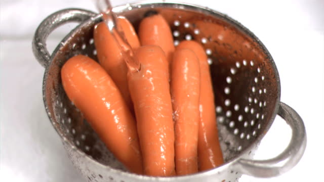 carrots being washed in super slow motion - medium group of objects stock videos & royalty-free footage