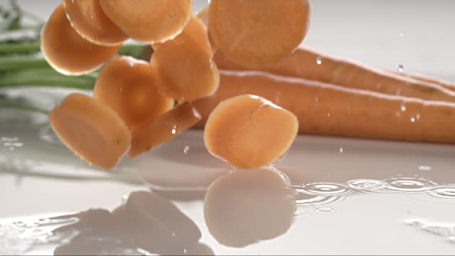 carrots falling and creating splashing droplets V1