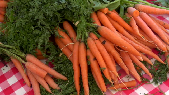 carrots sold at farmers market - market stall stock videos & royalty-free footage