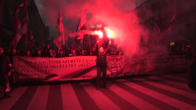 carrying polish flags and throwing red smoke bombs tens of thousands of people on saturday joined a march in warsaw organised by far right... - poland stock videos & royalty-free footage