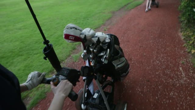 carrying the golf clubs - green golf course stock videos & royalty-free footage