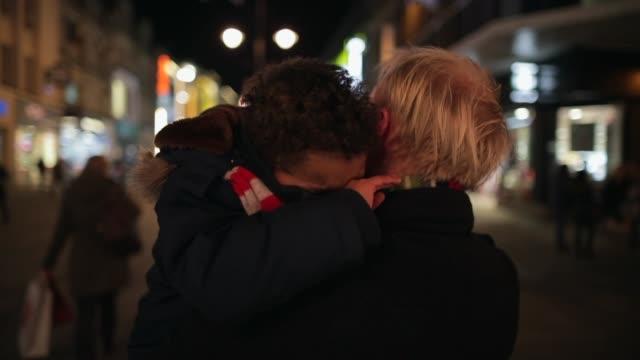 vídeos de stock e filmes b-roll de carrying tired son home - carrying