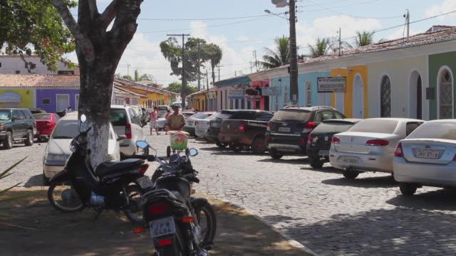 ws cars and bikes parked on street / porto seguro, bahia, brazil - porto seguro stock videos & royalty-free footage