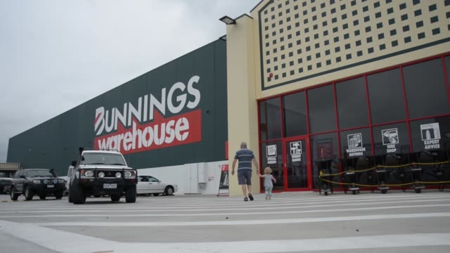 cars and customers pass the front of a bunnings store in altona store, a western suburb of melbourne, australia on tuesday, feb. 17 green bunnings... - diy stock videos & royalty-free footage
