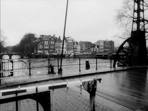 cars and cyclists travel across a cantilevered bridge in amsterdam - cantilever stock videos & royalty-free footage