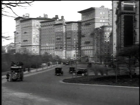 1916 ws cars and double-decker tour bus driving down a street / new york, new york, united states - 1916 stock videos & royalty-free footage