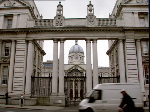 cars and pedestrains pass outside front of grand national gallery of ireland dublin - museum stock videos & royalty-free footage