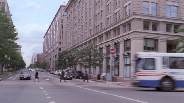 POV Cars and pedestrians making their way around the city / Washington, District of Columbia, United States