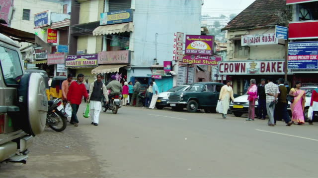 ms pan cars and pedestrians on busy street / india - rickshaw stock videos and b-roll footage