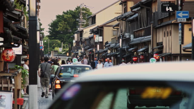 cars and pedestrians on hanamikoji street, kyoto - gion stock videos and b-roll footage