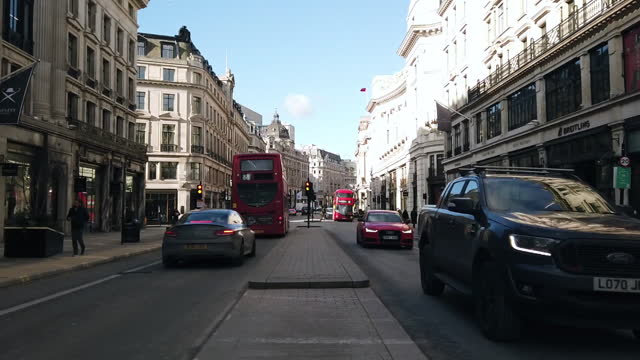 cars and pedestrians on regent street, hyper lapse in london, u.k., on wednesday, february 10, 2021. - traffic time lapse stock videos & royalty-free footage