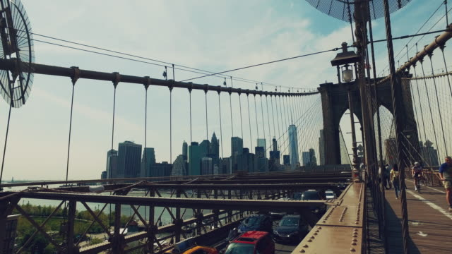 Cars and people on the Brooklyn bridge