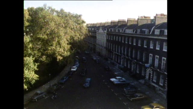 stockvideo's en b-roll-footage met cars and traffic driving through bloomsbury, london; 1972 - commercieel landvoertuig
