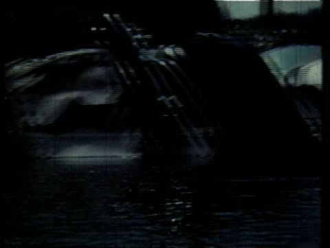 1966 pan cars and trucks lining the banks of the cuyahoga river / ohio, united states - fiume cuyahoga video stock e b–roll