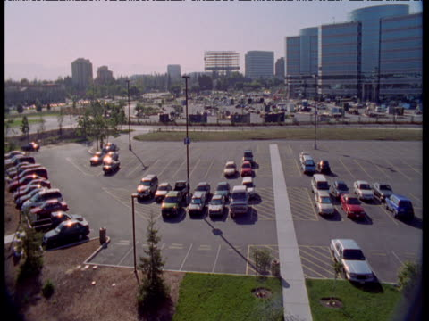 Cars and vans park up in car park, Bakersfield, California