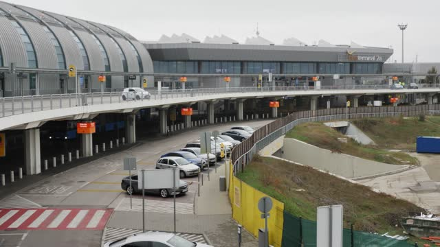 cars are parked at terminal 2a of liszt ferenc international airport on november 28, 2020 in budapest, hungary. budapest's airport suffer devastating... - hungary stock videos & royalty-free footage