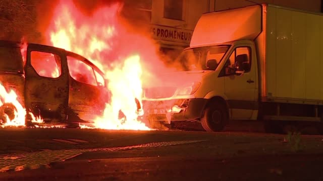 cars are torched as riots hit the french city of nantes for the third night following a deadly shooting of a young man during a stop and search... - nantes stock videos & royalty-free footage