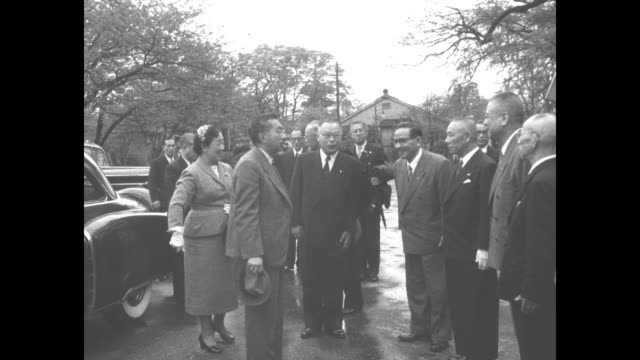 cars arrive at ueno zoo / emperor hirohito and empress negako are greeted and introduced to officials; they all bow / royal couple and tour party... - swimming trunks stock videos & royalty-free footage