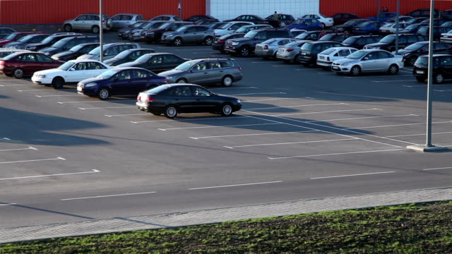 cars at the parking lot - parking stock videos and b-roll footage