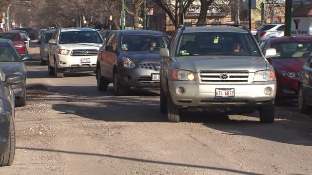 cars avoiding potholes on street - avoidance stock videos & royalty-free footage
