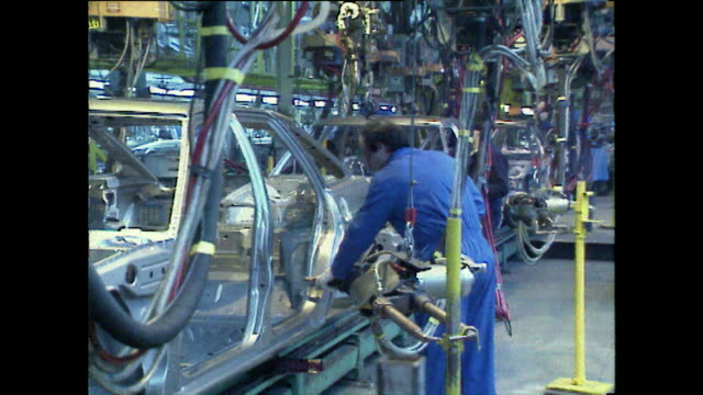 cars being assembled on uk production line; 1989 - medium group of people stock videos & royalty-free footage