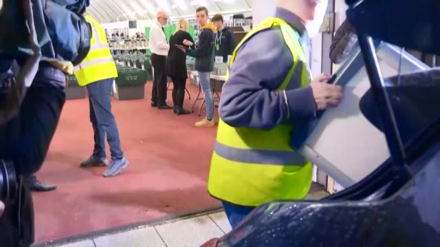 cars bring ballot boxes from the nearest polling stations to the counting site in uxbridge boris johnson's constituency in greater london - politische gruppe stock-videos und b-roll-filmmaterial
