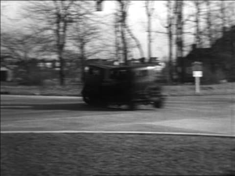 b/w 1934 pan 2 cars colliding on street / staged car collisions - 1934 stock videos & royalty-free footage
