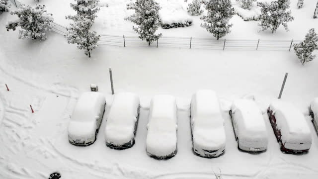 cars covered in snow and snowing - cars parked in a row stock videos & royalty-free footage