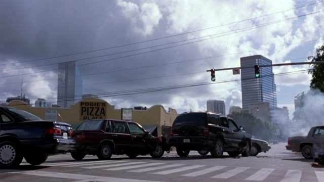 cars crash at an intersection in miami. - unfall konzepte stock-videos und b-roll-filmmaterial