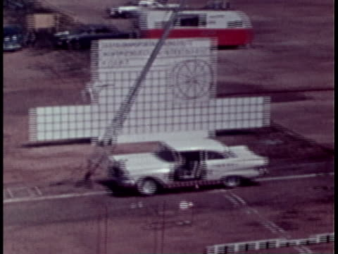 1970 montage cars crashing into breakaway poles during tests / united states - prova di collisione video stock e b–roll