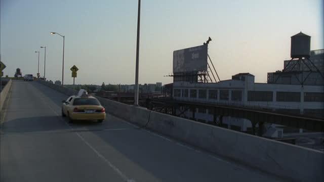 cars cross queensboro bridge heading towards manhattan. - yellow taxi stock videos & royalty-free footage