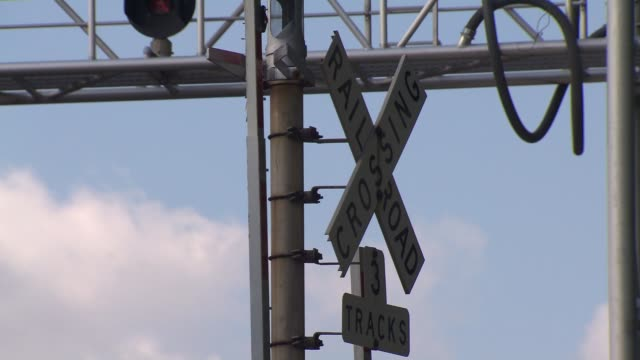 Cars cross railroad crossing and crossing gates lower in Chicago