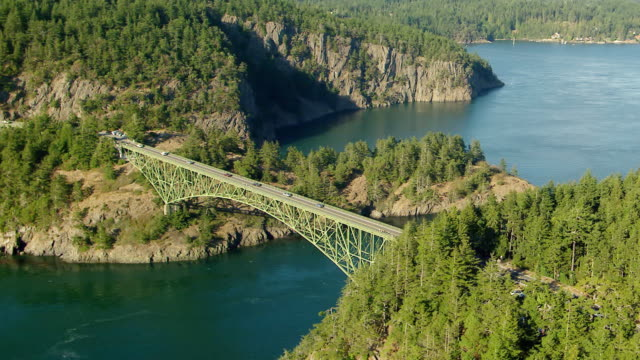 WS AERIAL POV cars crossing Deception Pass bridge / Washington, United States