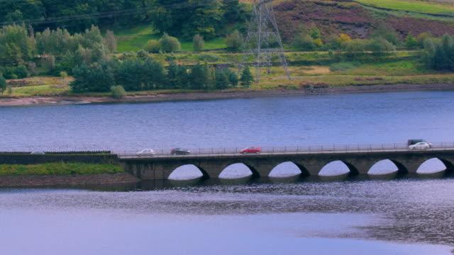 cars crossing low arched bridge a628, woodhead, derbyshire, england - derbyshire stock videos & royalty-free footage