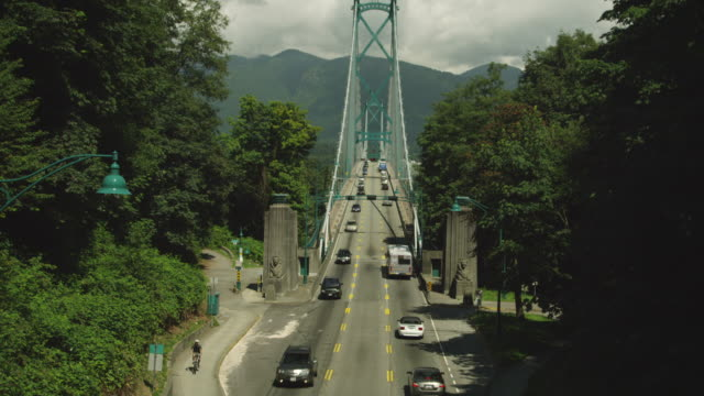 MS TU Cars crossing suspension bridge / Cortes, British Columbia, Canada