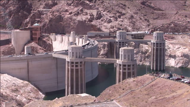cars drive across the roadway on hoover dam. - hoover dam stock videos and b-roll footage