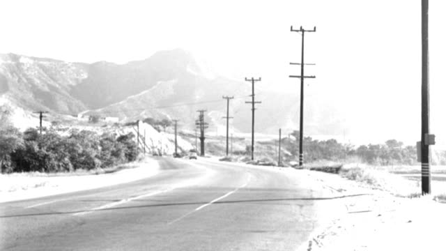 cars drive around a curve on a mountain highway. - 1958 stock videos & royalty-free footage