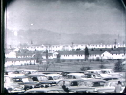 cars drive by a parking lot near the pentagon in washington d.c. - the pentagon stock videos & royalty-free footage