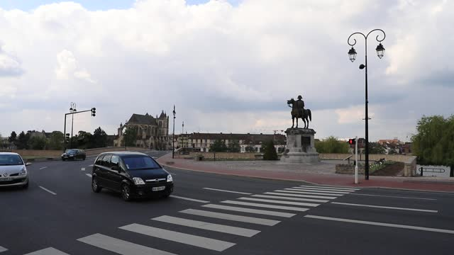 cars drive by an equestrian statue of napoleon i, a bronze work built in 1867 and created by charles-pierre-victor pajol to commemorate one of the... - french revolution stock videos & royalty-free footage